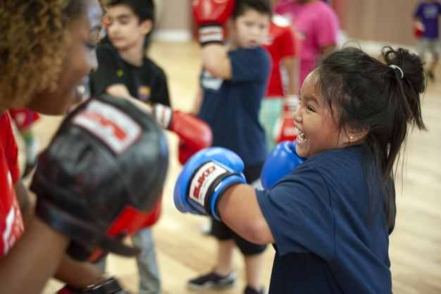 Kirsten Herson works on her punches with an instructor from the MJKO Boxing Club. - Justin Greaves/Torstar